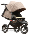 Baby Jogger City Elite Sand with seat reclined kicker raised plus Lambskin Stroller Fleece - click for larger image